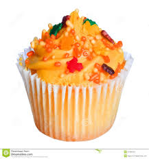 cupcake with orange frosting and colored sprinkles isolated on