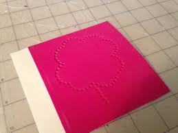 applying rhinestones to paper and a silhouette cameo print and