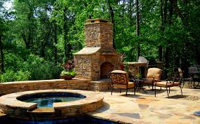 tub outdoor fireplace and kitchen love it dream backyard
