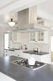 vent kitchen island black and white kitchen features a stainless steel vent placed