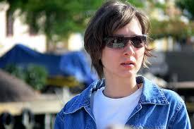 christine michael with short hair christine woman portrait jeans jacket glasses short hair