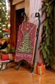 a classic christmas accent decorative antiqued wooden sled with