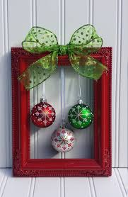 a vintage picture frame painted in glossy with a bow and a