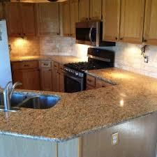 incredible venetian gold granite kitchen backsplash featuring