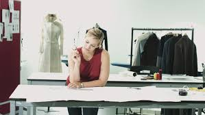 bureau de styliste fashion designer drawing in studio workshop stock footage