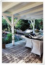 wohnideen minimalistischem pergola überdachte veranda holz schaukel bauen vordachbau ideen rund ums