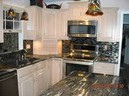 kitchen with black granite countertops homebase white tiles touch