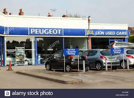 city peugeot used cars a peugeot dealership in a u k city stock photo royalty free