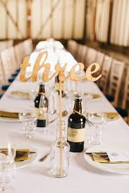 gold wine bottle table numbers diy gold wedding table numbers daveyard 5c0fd0f271f2