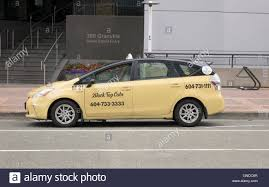 toyota canada a toyota prius vancouver canada black top taxi cab park in the