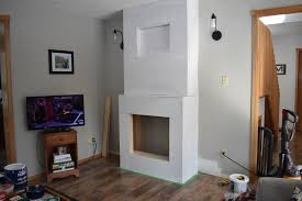 building a diy fireplace part 2 layers of paint and shiplap