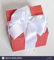 white silk ribbon gift box decorated silk ribbon and bow object on white studio