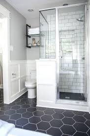 basement bathroom ideas with wall lamp above mirror and stand wash