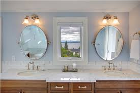 oval pivot bathroom mirror oval pivot mirrors and soft blue wall color for relaxing bathroom