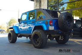 black and teal jeep jeep wrangler with 20in black rhino glamis wheels exclusively from