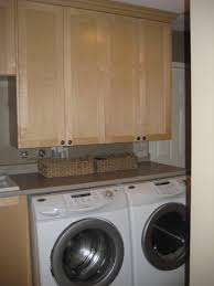 White Laundry Room Cabinets by Cream Wooden Cabinet On The Brown Wall Plus Double White Washing