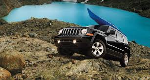 jeep with surfboard 5 reasons the jeep patriot is the best priced suv