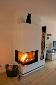 modern corner wood burning fireplace with firewood storage on the