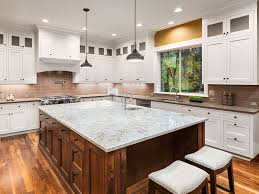 white kitchen cabinets brown countertops granite countertops mix match with cabinetry design tips