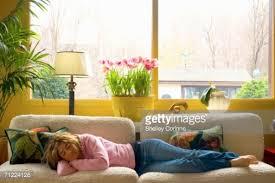 in livingroom relaxing in living room sprawled sofa stock photo