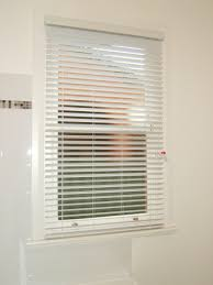 wooden blinds look a like are ideal for bathrooms and high