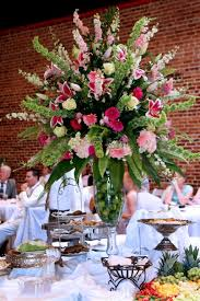 flower centerpieces pink and white lilly daisey and serving table centerpiece