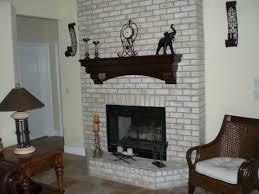 pretty kitchen design with natural brick wall and white furniter