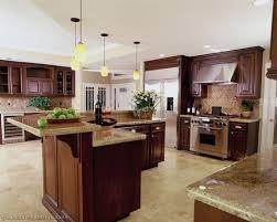 dark cherry wood kitchen cabinets brown wooden laminate flooring