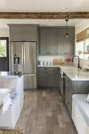 nice way to arrange built in fridge and cupboards that go flush to