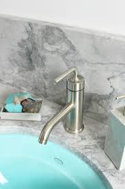 bathroom reno in progress quartzite counters aqua sinks and