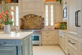 decor tile backsplash with two tone kitchen cabinets and granite