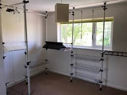 telescopic wardrobe organiser hanging rail clothes rack storage