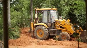 jcb bulldozer tractor digging soil in india 2 stock video footage
