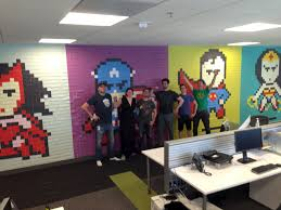 employee improves drab office with post it note superhero art other stories