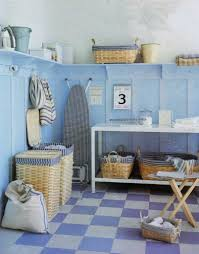 sophisticated turquoise cabinet with washing machine storage and