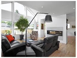 elegant living room living room double sided fireplace beige walls
