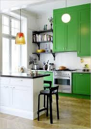 inspiring green painted wooden kitchen cabinets with stainless