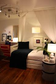 tiny bedroom ideas unique ceiling lighting above wooden floor and single bed plus