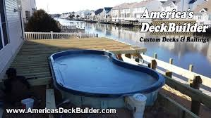 waterfront trex pool deck with glass baluster railing bayville