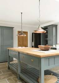a lovely big farmhouse sink with devol aged brass taps carrara