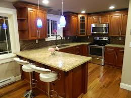 traditional kitchen with raised panel u0026 pendant light in seattle