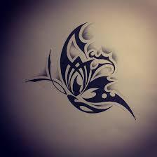 flying black tribal butterfly design tattoos