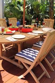 hawkesbury 9 piece teak oval extending outdoor setting