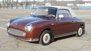 nissan figaro owner wants exorbitant amount for brown left hand drive 1991