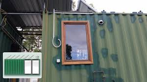 shipping container house u2013 installing wooden window in kitchen