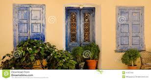 ornamental blue doors and windows samos greece stock photo