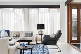 dark blue coloured pelmet with cream coloured sheer curtains
