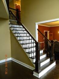 wood stairs and rails and iron balusters oak handrail and box