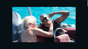 obama learns to kitesurf while on vacation cnn video