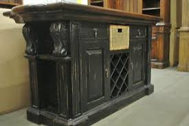 distressed black kitchen island carved corbels on the corners it is truly an outstanding